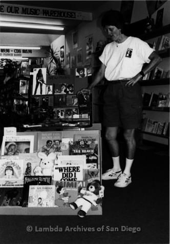 P167.097m.r.t Paradigm Women's Bookstore: Karen Merry standing by music display