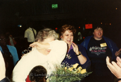 """""""The Magic Music Makes"""" San Diego Women's Chorus (SDWC) first choral festival with Sister Singers 1991: Chorus Business Director Peggy Heathers crying as she receives Thank you flowers."""