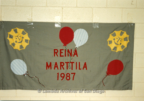 P019.028m.r.t AIDS Quilt at San Diego Golden Hall 1988: Green quilt with balloons and smiling suns dedicated to Reina Martilla