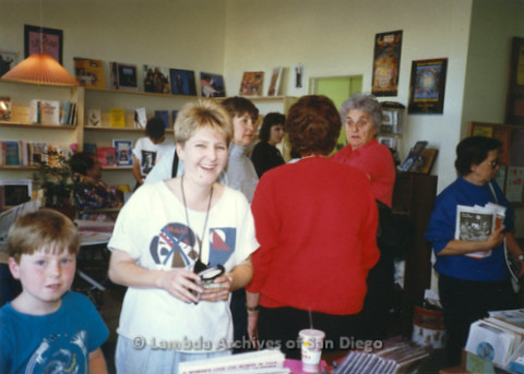 P169.071m.r.t Paradigm Women's Bookstore Grand Opening: Woman and child smiling, other women in background socializing