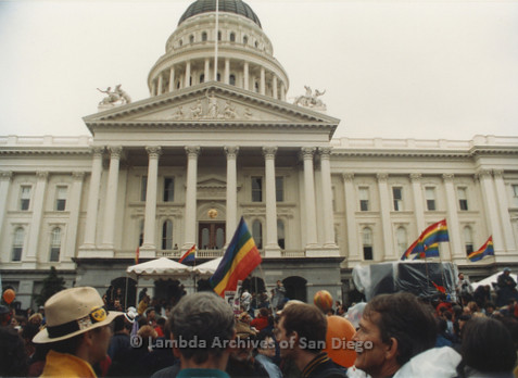 P019.163m.r.t March on Sacramento 1988 / Pre Parade gathering: The front of City Hall with a large group of people gathered in front