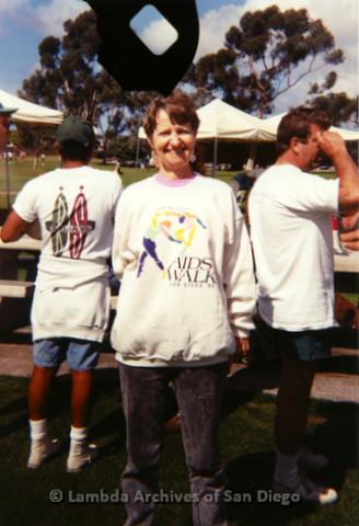 P197.036m.r.t AIDS Walk San Diego 1993: Sharon Parker standing in volunteer sweatshirt at Crown Point picnic