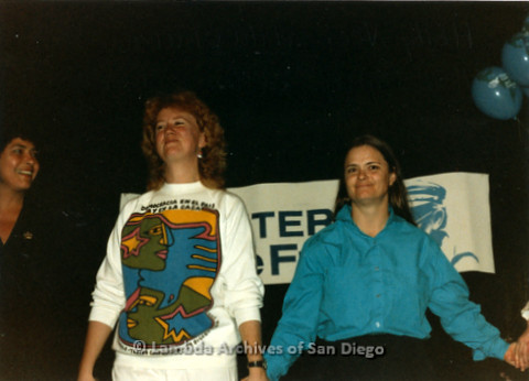 Feminist, Peace Activist and Folk Singer Holly Near (left) and American Sign Language Interpreter Bonnie Sherwood (right) on stage holding hands during Holly's performance at the Unitarian Universalist (UU) Church in San Diego