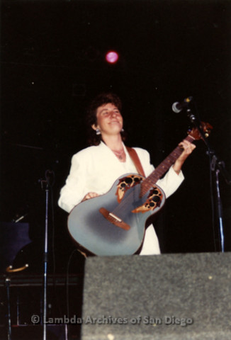 West Coast Women's Music and Comedy Festival, Produced by Robin Tyler in Yosemite, California, Labor Day Weekend 1991. Lesbian Performer, Lucie Blue Tremblay singing and playing her Blue Guitar on the Festival Night Stage.