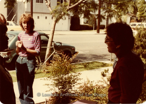 Blood Sisters blood drive, 1983: Lola Halpern (pink striped shirt) standing with Kim McAlister outside Blood Bank