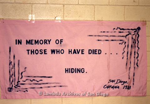 """P019.027m.r.t AIDS Quilt at San Diego Golden Hall 1988: Quilt inscribed """"In memory of Those who have died…hiding."""""""