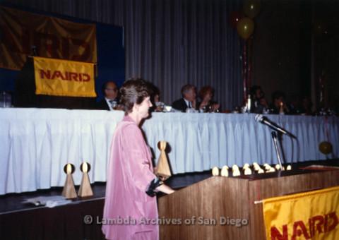 P168.003m.r.t National Association of Independent Record Distribution event: Karen Merry at podium holding an award