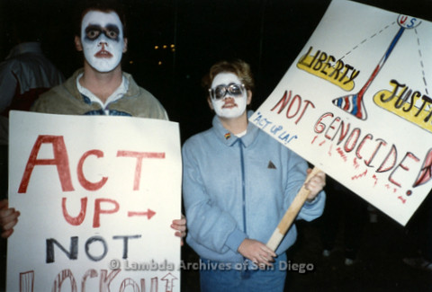 "P019.337m.r.t Los Angeles ""Die In"" 1988:  Two people with skull makeup holding signs that read: ""ACT UP -> NOT LOCK OUT"", ""LIBERTY JUSTICE NOT GENOCIDE ACT UP LA!"""