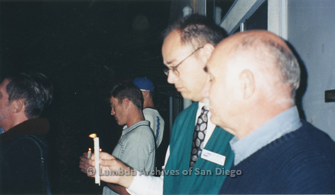 P236.003m.r.t Matthew Shepard Memorial at The Center 1998: Close up of two men holding candles