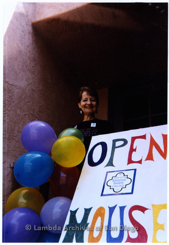 "P200.003m.r.t 1994 Open House: Sharon Parker standing behind ""Open House"" sign"