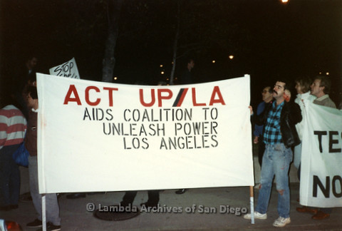 """P019.342m.r.t Los Angeles """"Die In"""" 1988: Protesters carrying banner that reads: """"ACT UP/ LA  AIDS COALITION TO UNLEASH POWERS  LOS ANGELES"""""""