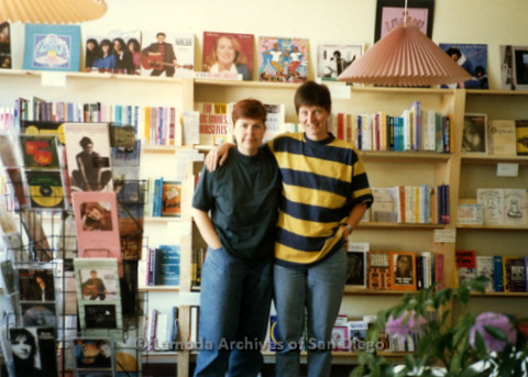 P169.103m.r.t Paradigm Women's Bookstore Grand Opening: Two women posing in front of bookshelves
