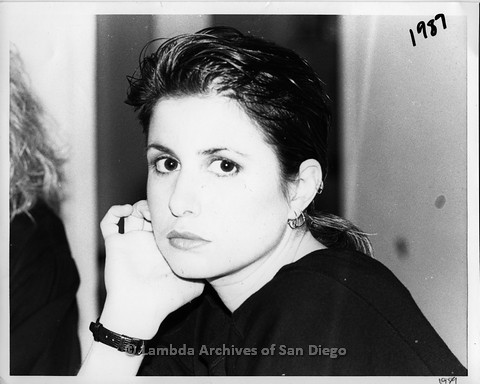 """March 1989 - """"So Many Women"""" Video Shoot: Zanne Seated at The Bar Area Playing Her Guitar at The Flame, Lesbian Dance Club."""