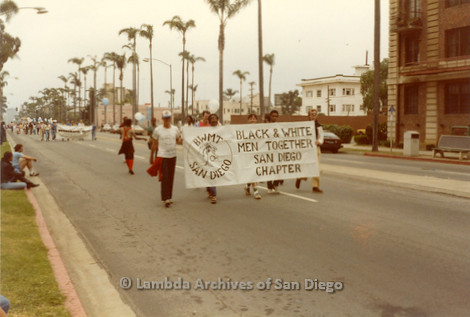 1982 - San Diego Lambda Pride Parade, 'B.W.M.T.' Black and White Men Together - San Diego Chapter members march in the Pride Parade holding their banner.