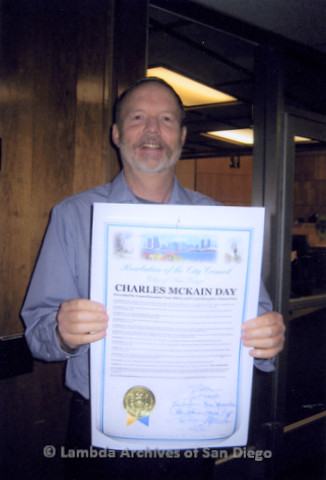 """P338.064m.r.t Charles McKain holding an award proclamation entitled """"Charles McKain Day"""" from the San Diego City Council"""