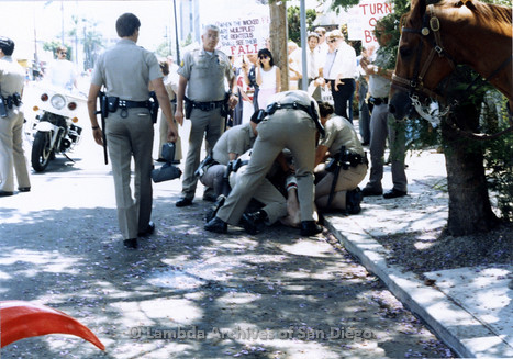 San Diego Lambda Pride Parade: Police officers restraining a Gay Man from the San Francisco Lesbian/Gay Freedom Band, provoked by the hundreds of Christian Fundamentalist protesters on Fifth Avenue in Hillcrest.
