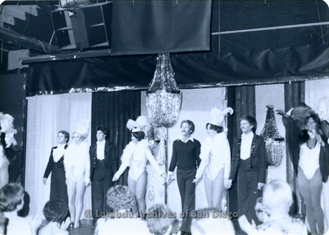 P355.052m.r.t Mixxed Company: Performers taking a bow on stage with chandelier above them