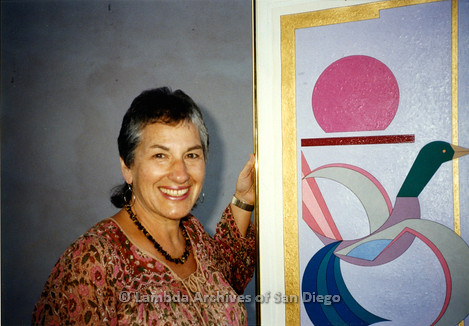 "P199.003m.r.t Artist and staff/volunteer trainer at San Diego AIDS Project, Ona Yufe with her piece, ""Panel of Love"""