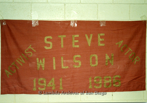 P019.063m.r.t AIDS Quilt at San Diego Golden Hall 1988: Red quilt dedicated to activist and actor Steve Wilson