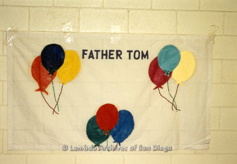P019.054m.r.t AIDS Quilt at San Diego Golden Hall 1988: White quilt with balloons dedicated to Father Tom