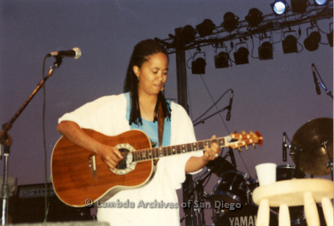 West Coast Women's Music and Comedy Festival Produced by Robin Tyler in Yosemite, California, Labor Day Weekend 1991. Lesbian Performer, Diedre McCalla playing guitar on The Festival Main Stage.