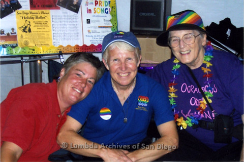 San Diego LGBT Pride Festival, July 2006: Sheila Clark (right) and two other members of the San Diego Women's Chorus in their LGBT Pride Festival Booth.