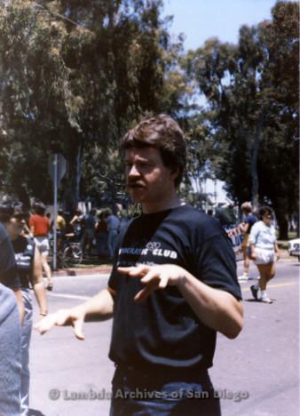 San Diego Lambda Pride Parade: LGBT Activist, Doug Scott Stands at the Corner of Laurel Street and Balboa Park Drive where the Parade starts, wearing a San Diego Democratic Club T-shirt.