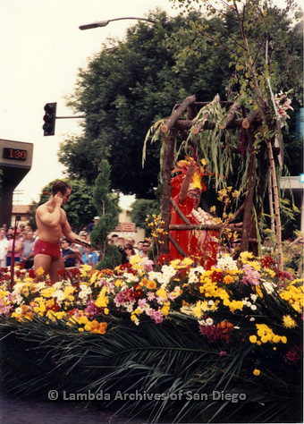 P018.097m.r.t San Diego Pride Parade 1991: Float covered in flowers (Hawaiian?)