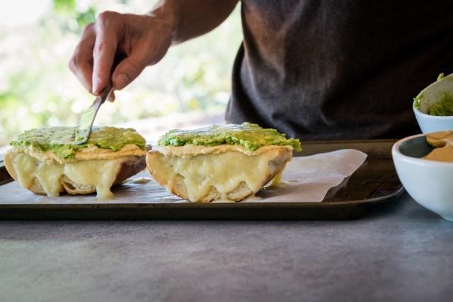 spreading the avocado