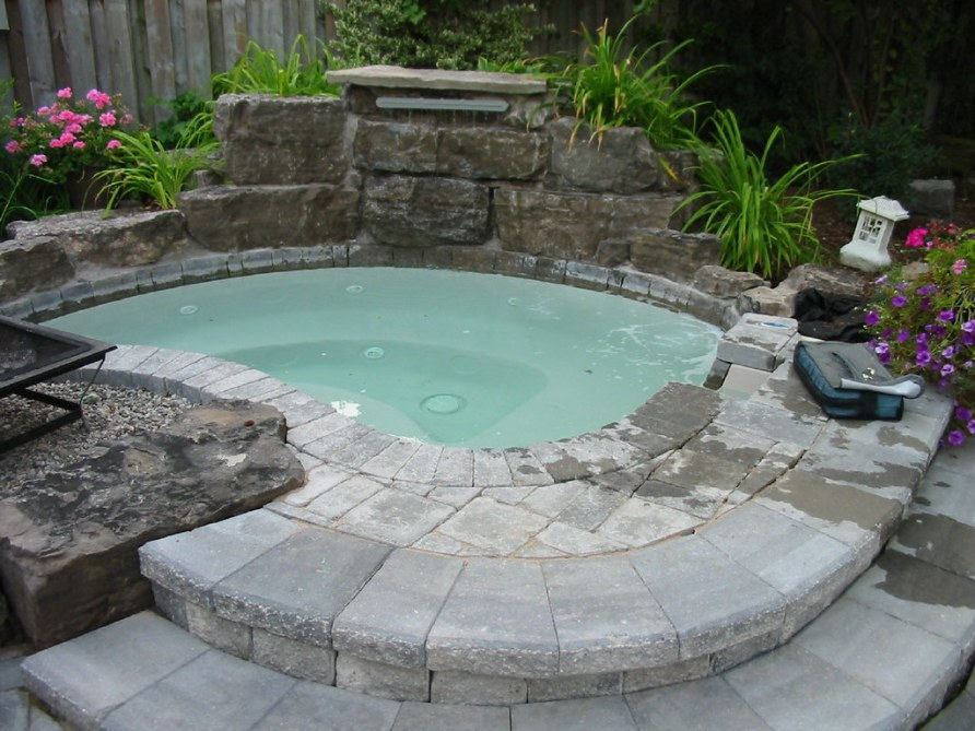 awesome-outdoor-hot-tub-designed-with-stoned-desk-floor-tile-also-decorative-white-lantern-idea