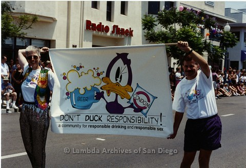 1994 - San Diego LGBT Pride Parade: Contingent - Earl Storm (right) Creator of 'Buckminster Duck' Cartoon, promoting Safer Sex Practices.