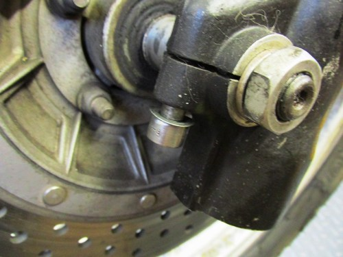 Remove Front Axle Pinch Bolt