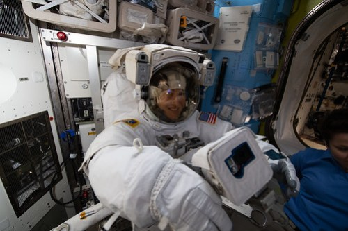 NASA astronaut Christina Koch is fitted in a U.S. spacesuit