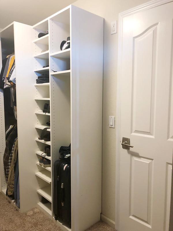 Inside the closet facing the door
