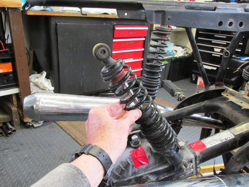 Rotate Top of Left Shock To Free It From Housing
