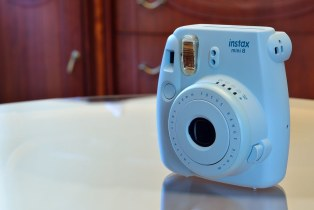 The photo shows FujiFilm Instax Mini 8