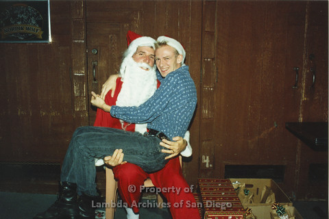 P001.291m.r.t X-mas: man in blue shirt sitting on Santa's lap