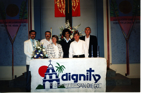 P103.143m.r.t Judy and another standing in front of four men at Dignity San Diego alter
