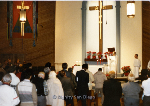 P103.045m.r.t Dignity San Diego: Church congregation standing with heads bowed