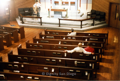 P103.058m.r.t Dignity San Diego: Person playing guitar in church