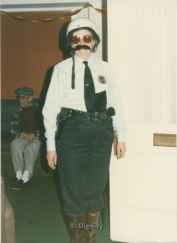 P104.105m.r.t Dignity San Diego: Person wearing a police themed costume
