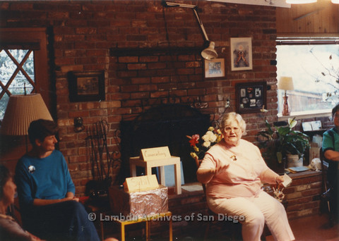 P024.372m.r.t  A woman speaks while seated as Judith McConnell (left) in blue looks on.