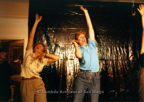 P024.167m.r.t Ellie Rapp (left) and Judith McConnell (right) raising a hand high while on stage