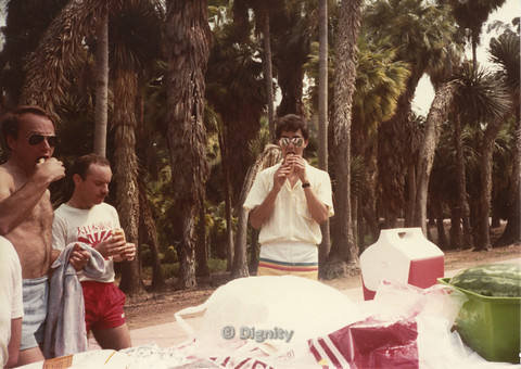 P104.056m.r.t Dignity Picnic 4th of July: Three men eating hotdogs