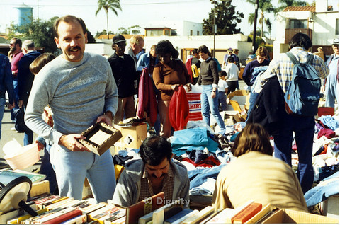 P104.005m.r.t Dignity church and MCC yard sale: Gary looking at camera with an item in hand
