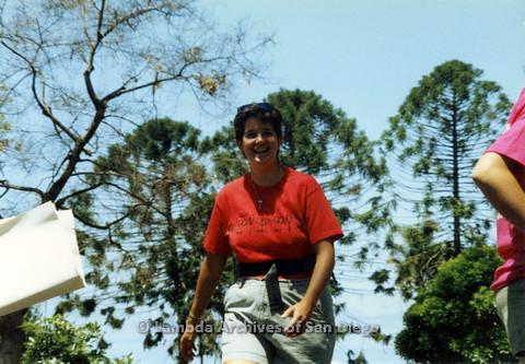 P024.525m.r.t 1990 San Diego Pride: Woman in red San Diego Lesbian Press shirt