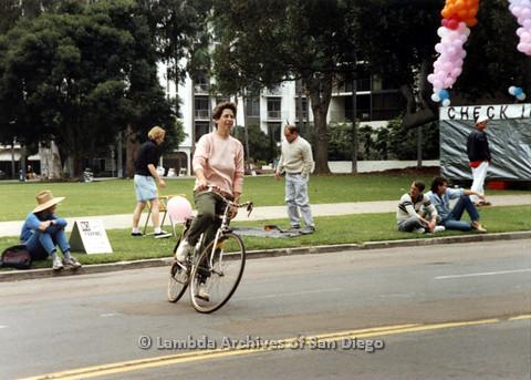 P024.499m.r.t 1990 San Diego Pride: Debbie Zang riding a bike