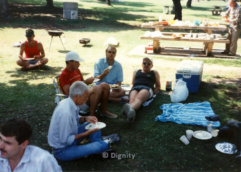 P104.053m.r.t Dignity Picnic 4th of July: Bruce Neveu (blue polo) eating under the shade with unidentified men