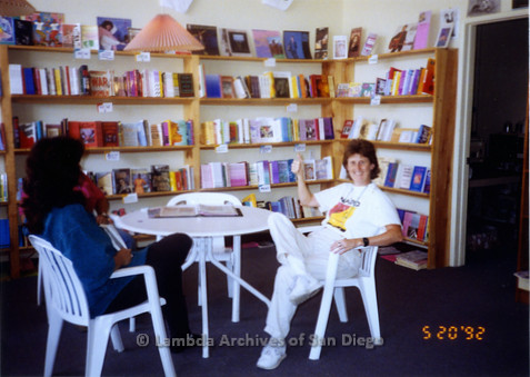 P167.005m.r.t Paradigm Women's Bookstore: Karen Merry inside bookstore, giving a thumbs up