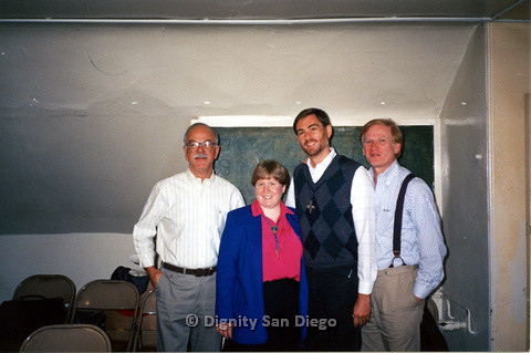 P103.136m.r.t Dignity San Diego:  Woman wearing a bolo tie and three men, one wearing a cross